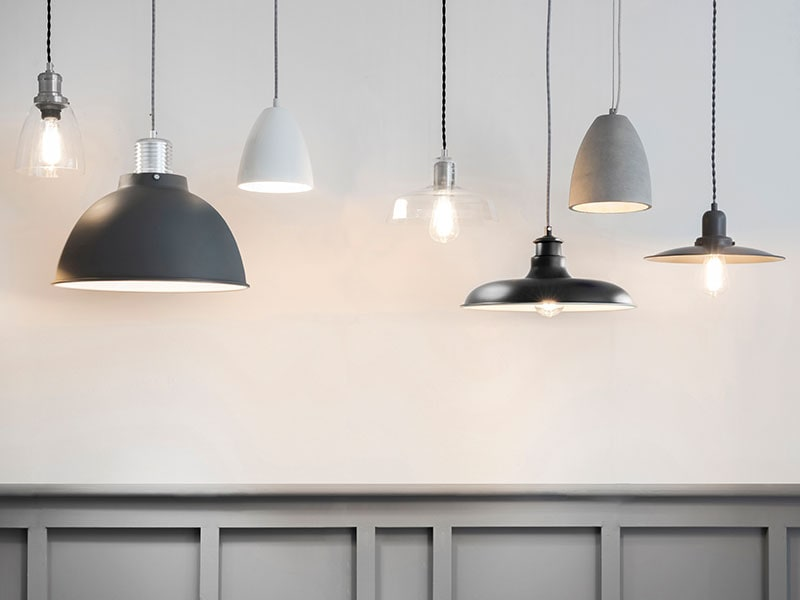 Indoor lighting hung from the ceiling at different heights