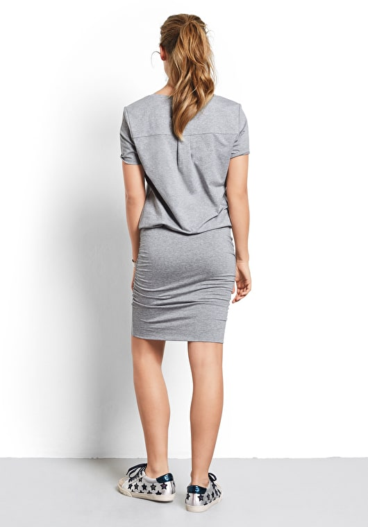 Our Tara dress is made up of a tight skirt and a v neck tee, in a beautiful grey marl.