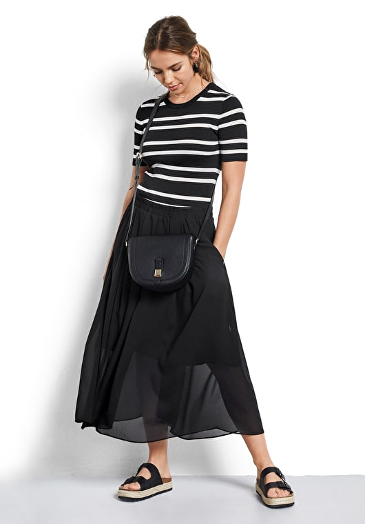 Model wears our Stretch jersey ribbed top with a round neck and short sleeves in black and white stripes