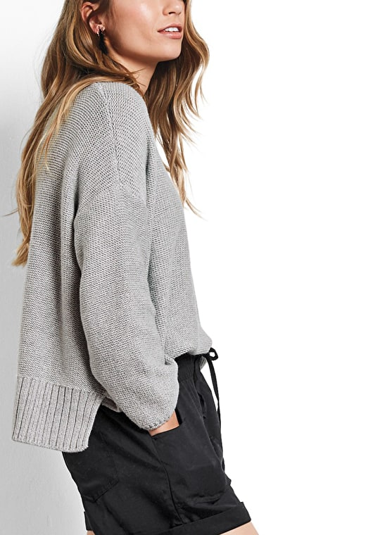 Model wears our oversized knitted boxy jumper in grey