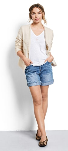 Model wears our Classic denim shorts with a distressed star pattern