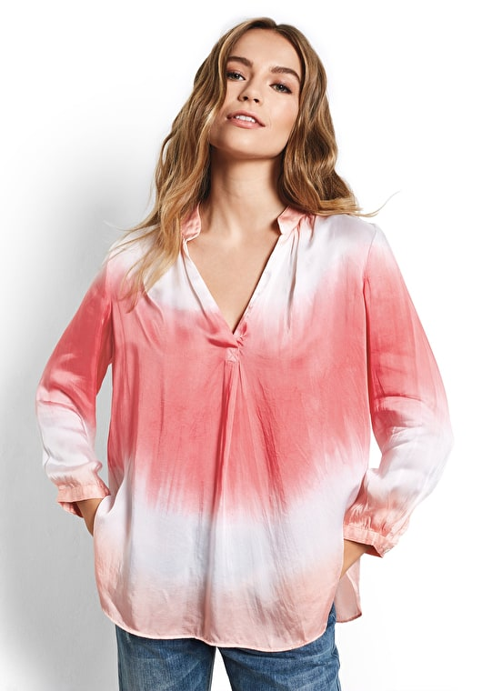 Model wears our Draped style oversized v neck top in white and guava
