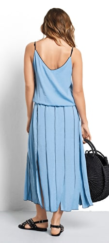Model wears our gorgeous pleated panel dress in a stunning baby blue with a flattering v neckline