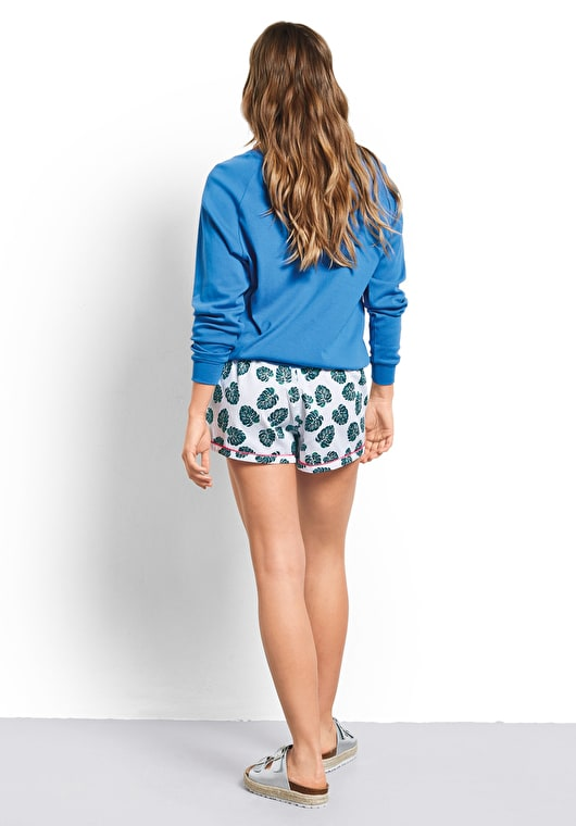 Women wearing our printed monstera leaf piped cotton pyjama shorts with a pink trim