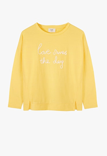 Embroidered 'Love Saves the Day' long sleeve tee in yellow and white