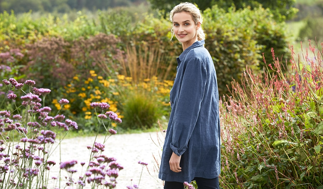 New Linen Collection, Blonde girl wearing linen tunic next too some beautiful cornish hedgerows.