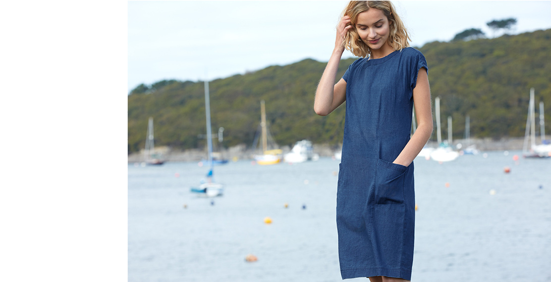 Blonde haired woman stood in front of the Helford River