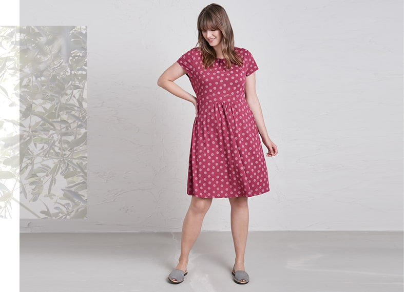 Plus size lady wearing the Carnmoggas Dress in red polkadot