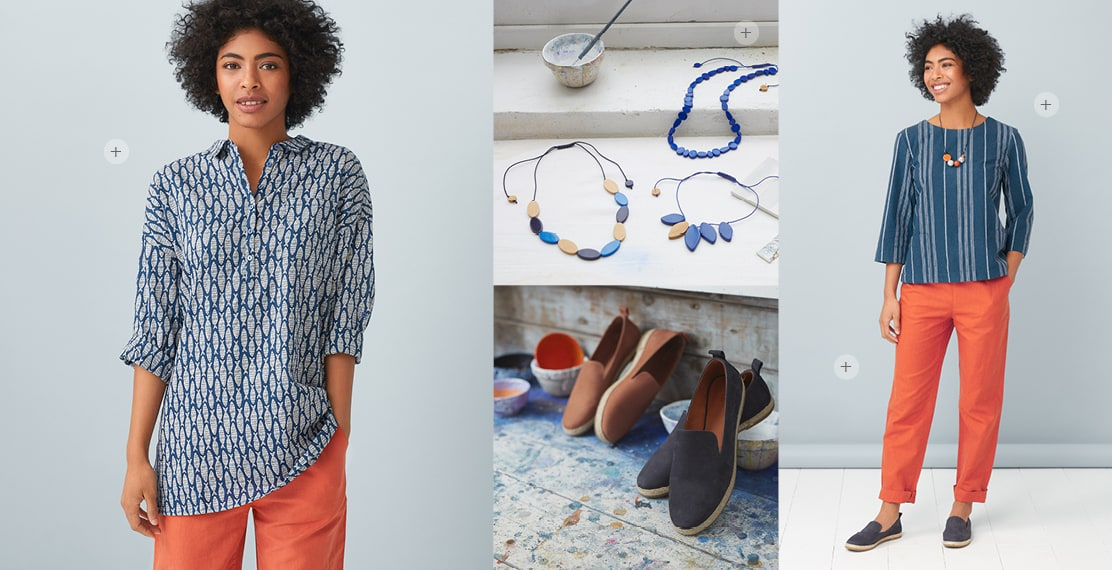 Colour necklaces & slip on shoes on paint splattered studio floor. Women wearing bright coral trousers and a geometric fish patterned shirt.